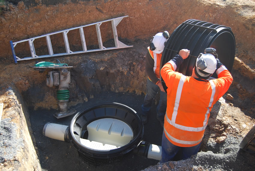 Plastic Manhole Chamber Installation - Lifting in Riser