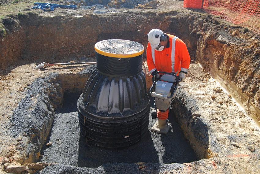 Plastic Manhole Chamber Installation - Compacting Backfill
